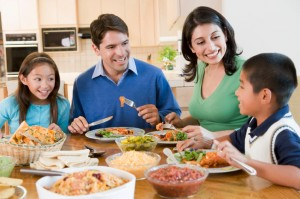 family enjoying organic meal