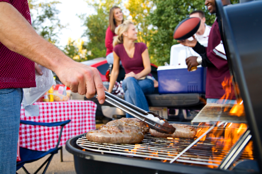 family-grilling-football