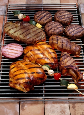 assorted organic meat on a grill